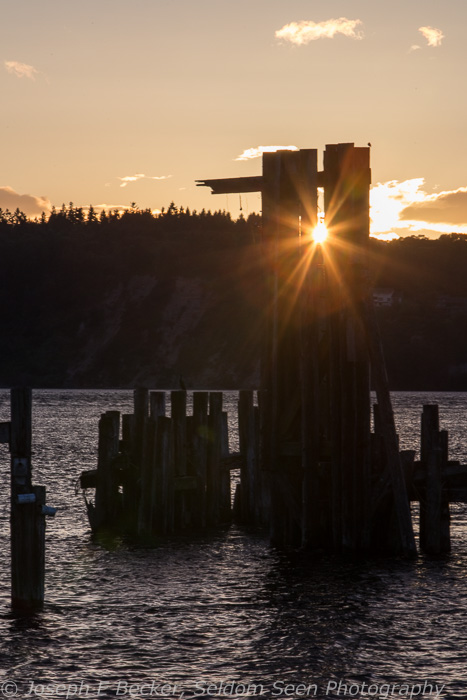 Attracted by the sun peeking through the pilings, I wanted to capture a light star and did succeed. Unfortunately, I forgot about getting a level horizon, and fixing that in Lightroom causes the piling on the left to be too close to the frame edge. Trying to bring detail in the dark part of the image just brings unacceptable digital noise.
