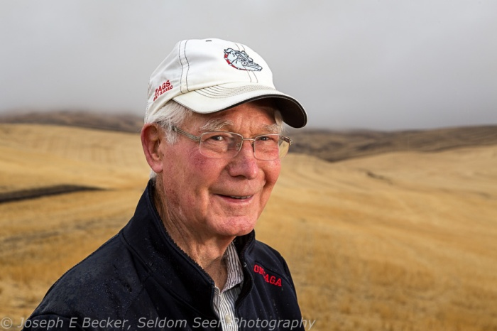 Here's my Dad, Ernie Becker. Dad braved the rain while I took this shot. We were on the shoulder of Bald Butte, along Becker Road, north of the town of Colton.