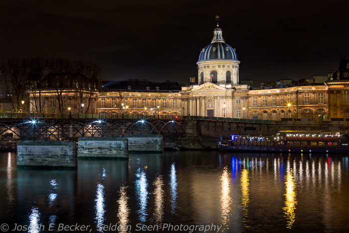 Reflections in the Seine looking toward the Palace of the Institute of France and the Pont des Arts bridge