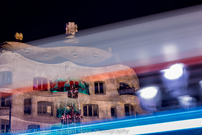 Shooting at night can give lucky accidents, such as this shot of La Pedrera with a bus driving through the frame during the exposure