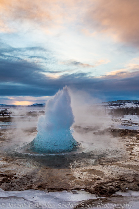 The Strokkur geyser starting an eruption at Geysir