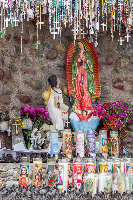 Shire to the Virgin Mary, covered with rosaries and candles