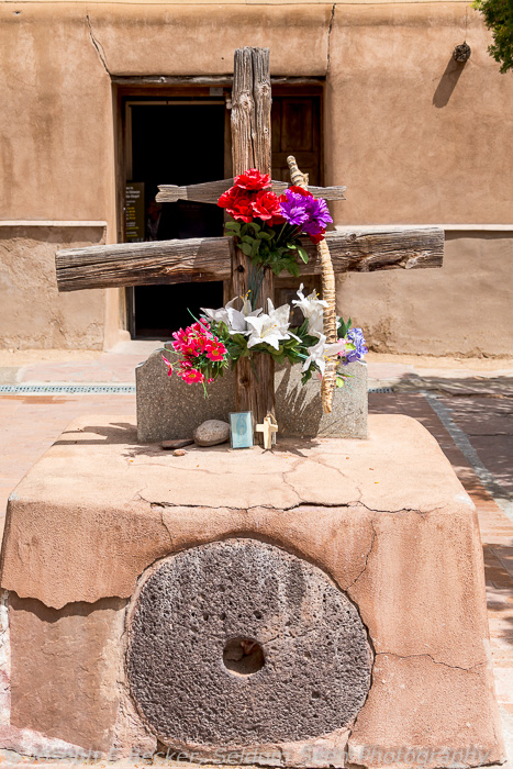 Cross in the courtyard of the Santuario de Chimayo