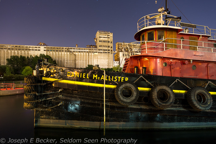 Tug boat Daniel McAllister and abandoned grain silos/elevators near Old Montreal shot at night
